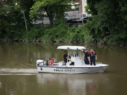 Wilmington firefighters search the Brandywine near Governor Printz Blvd. Tuesday for Miguel del Valle, who went missing Monday.