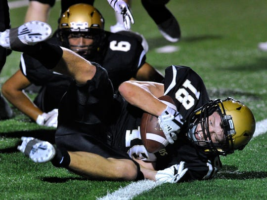 Abilene High School's Colton Wilson recovers a San Angelo Central fumble for the Eagles during Friday's game at Shotwell Stadium Sept. 1, 2017. Abilene High went on the score shortly after.