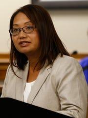 Maysee Yang Herr tells County Board members that Brad