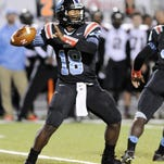 Zachary quarterback Lindsey Scott drops back to pass on friday night against Parkway.