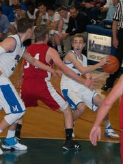 McConnellsburg guard Nic Culler, with the ball, is guarded by Austin Raymer of Fannett-Metal (34) during the Spartans' 58-39 victory Friday night.