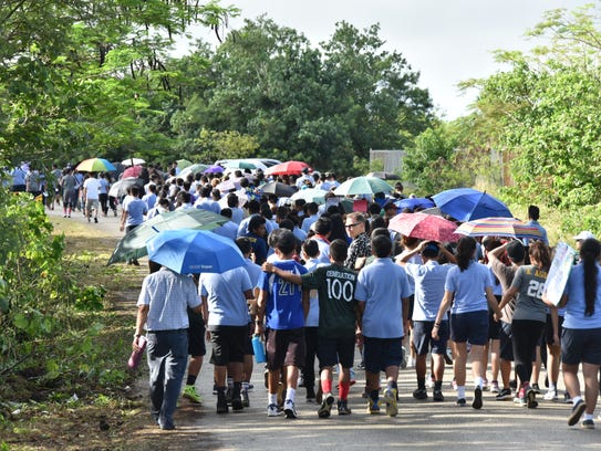 Students from VSA Benavente Middle School march to