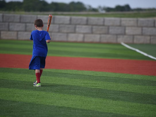 Whitaker Hanson chases after a ball on his family's