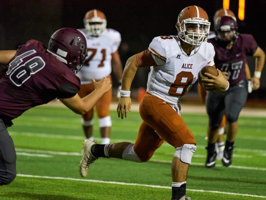 Alice's Trey Jaramillo runs for yardage against Flour