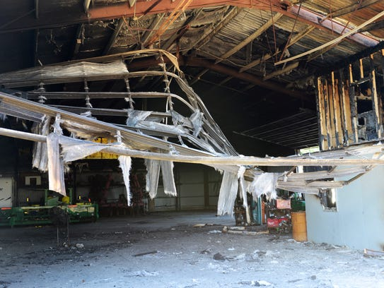 A fire destroyed two barns and and farm equipment on