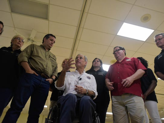 Sen. Ted Cruz and Gov. Greg Abbott speak to the media