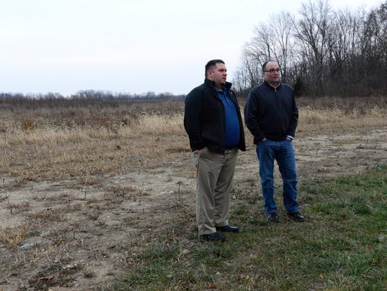 Gibsonburg mayor Steve Fought, left, and village administrator