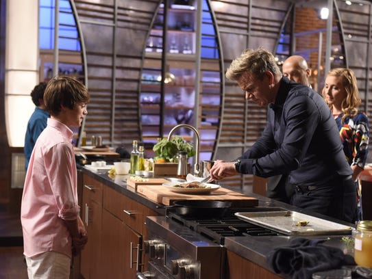 "Chef Gordon Ramsay looks at Cade Ortego's dish on ""MasterChef Junior."""