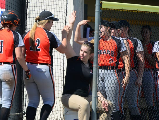 Jasmine McNett returns Wednesday to Gibsonburg's dugout after a home run.