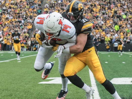 Iowa's Brandon Snyder hits Illinois tight end Louis Dorsey which prevented an Illini first down on Saturday, Oct. 7, 2017, at Kinnick Stadium in Iowa City.
