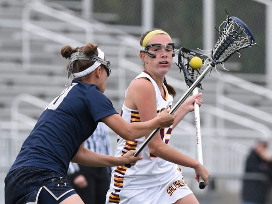 Salisbury's Megan Wallenhorst protects the ball from UMW's Maggie Nunn during the Capital Athletic Conference women's lacrosse semifinal. Salisbury won 6-4.