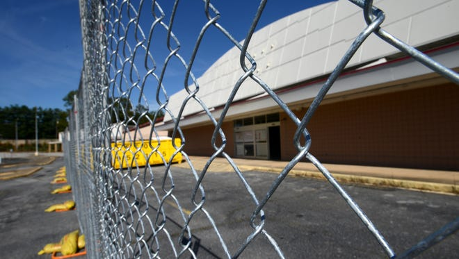 A construction fence surrounds the former Kmart building on Sulphur Springs Road in Berea.