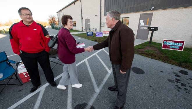 From the left, Rob Stone running for Dover Township Supervisor, while Cynthia Crone greets Doug Hoke running for County Commissioner at Dover Township #2 polling place Election Day Tuesday November 3, 2015