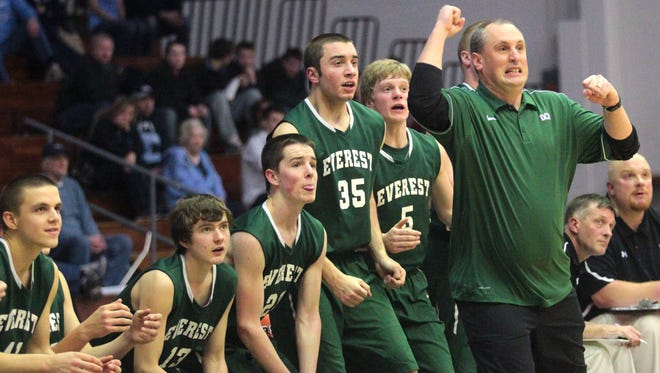 D.C. Everest coach Cory Heckel and the bench react to a basket during the fourth quarter of a WIAA Division 1 sectional semifinal game against Superior in Marshfield in 2013.