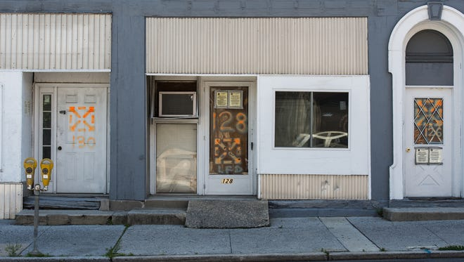 Three buildings in the 100 block of N. Eighth Street are marked with an 'x.' The Lebanon City Fire Department marks condemned buildings with an orange 'x' to let people and firefighters that they should stay out of the building.