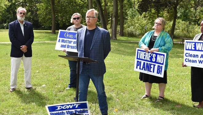 A coalition of scientists, activists and religious leaders spoke about the need to keep funding the EPA during a Sept. 7 press conference at Farmington's Shiawassee Park. Speaking is EPA National Vehicle and Fuel Emissions Laboratory employee Mark Coryell, center.