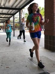 Gifford Middle Heart & Sole team members run during