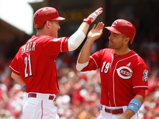 Cincinnati Reds' Todd Frazier (21) is congratulated by Joey Votto (19) after Frazier hit a two-run home run off Miami Marlins starting pitcher David Phelps in the first inning of a baseball game Sunday.
