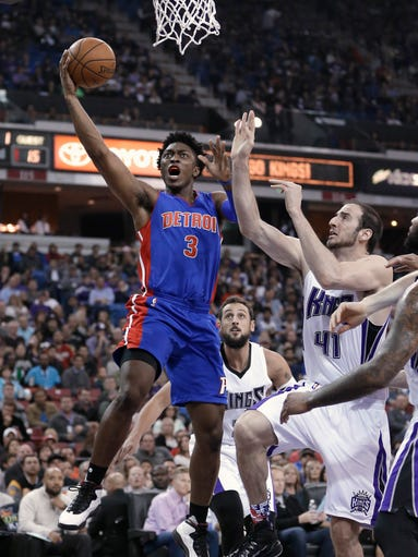 Detroit Pistons forward Stanley Johnson, left, drives