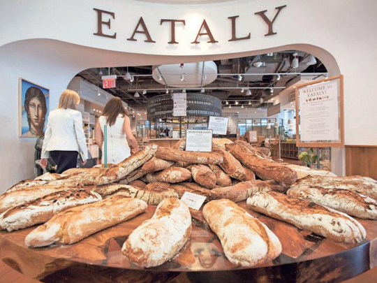 Freshly baked breads are displayed at the entrance
