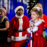 "Fina Strazza, center, appears in a scene from ""A Christmas Melody,"" directed by Mariah Carey. Carey, Lacey Chabert, Brennan Elliott, Kathy Najimy and 10-year-old Broadway sensation Strazza star in the holiday special that premieres on Dec. 19."
