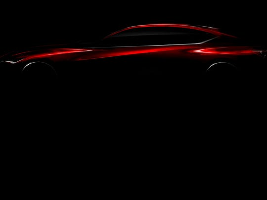 Acura plans to reveal a luxury sedan at the North American International Auto Show in January. This image of the Acura Performance Concept hints at its design.