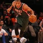 Milwaukee Bucks forward Giannis Antetokounmpo grabs a loose ball during the first quarter against the New York Knicks on April 10 at Madison Square Garden in New York City.