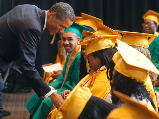 President Barack Obama greets graduates, some overcome with emotion, before he delivers the commencement address at the Booker T. Washington High School graduation at Cook Convention Center in Memphis, Tenn., Monday, May 16, 2011. (AP Photo/Charles Dharapak)