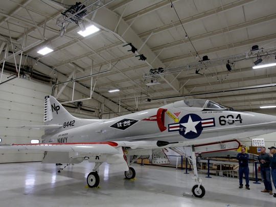 The Douglas A-4 Skyhawk sits inside a hanger at the