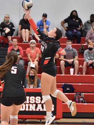 Melissa's Faith Fortenberry (20) tips the ball against Nocona during a home non-conference match at home on Sept. 15.