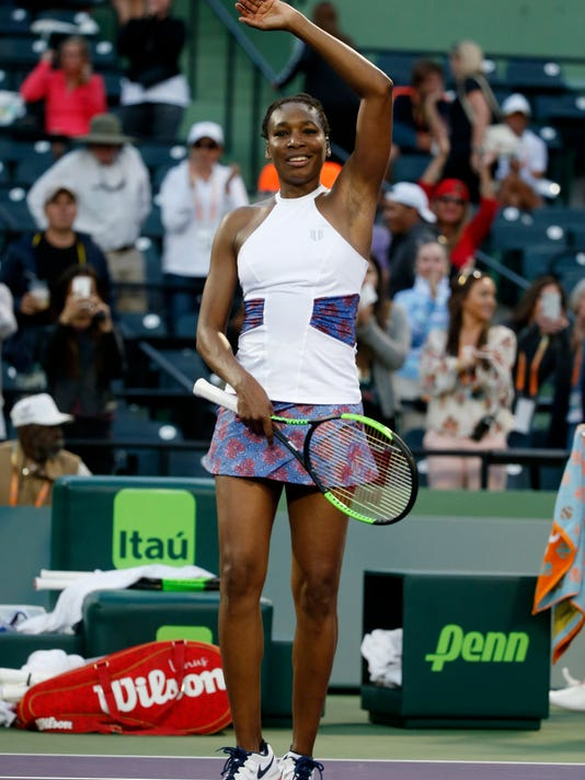 Venus Williams celebrates after defeating Natalia Vikhlyantseva, of Russia, in a tennis match at the Miami Open, Friday, March 23, 2018, in Key Biscayne, Fla. (AP Photo/Wilfredo Lee)