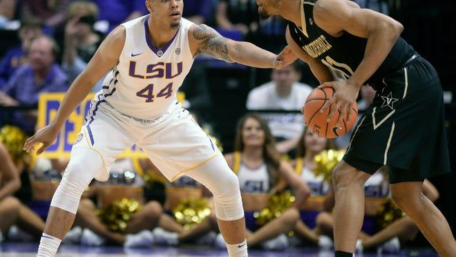 LSU forward Wayde Sims (44) defends against Vanderbilt forward Jeff Roberson (11) during an NCAA college basketball game, Tuesday, Feb. 20, 2018 in Baton Rouge, La. (Hilary Scheinuk/The Advocate via AP)