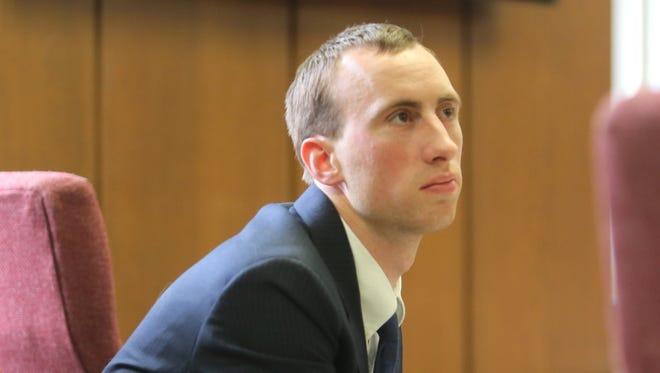 Aaron Pelletier sits in court.
