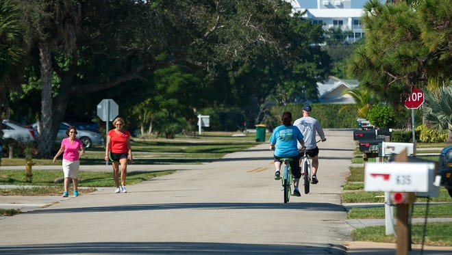 Pedestrians and bicyclists circulate through the Naples Park neighborhood in North Naples on Thursday, Nov. 17, 2016. The name Naples Park is planned to be changed to North Naples on the signs on Interstate 75.