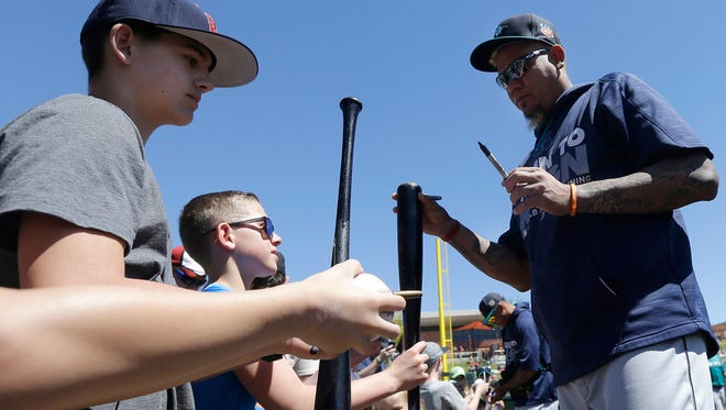 Seattle Mariners starting pitcher Felix Hernandez signs autographs before a spring training baseball game between the Colorado Rockies and the Mariners in Scottsdale, Ariz., Saturday, April 2, 2016.