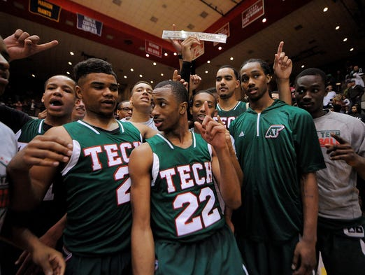 Arsenal Tech celebrates their trip to the state finals after beating Bloomington North during the Class 4A Semistate game, Saturday, March 22, 2014, inside the Tiernan Center at Richmond High School. Tech won the game 75-71.