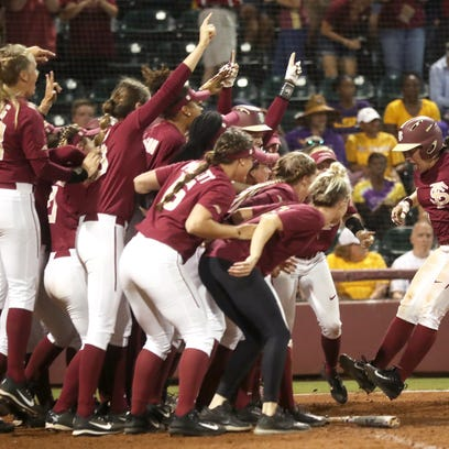 FSU's Anna Shelnutt, right, is greeted by her teammates