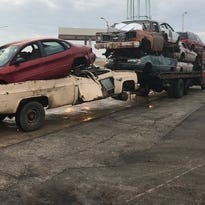 Trucker cited for hauling wagon train of 8 crumpled, wrecked vehicles on Milwaukee interstate
