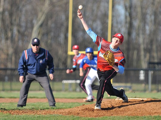 Ridgedale's Monroe Britton pitches their game against Crestline Friday afternoon.