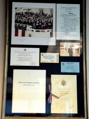 Photos and programs from President Ronald Reagan's 1981 inauguration, signed by politicians in attendance, in Gerry Frank's office in Salem on Monday, Oct. 20, 2014.
