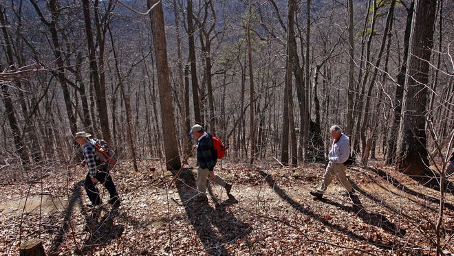 Hikers take a walk in the Bent Creek Experimental Forest. The area, managed by the U.S. Forest Service, is closed due to the winter storm.