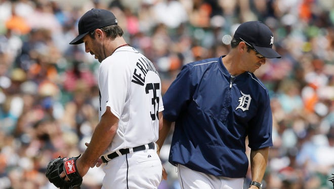 Detroit Tigers starting pitcher Justin Verlander, left, is relieved by manager Brad Ausmus during the fourth inning against the Baltimore Orioles on Sunday, July 19, 2015, in Detroit.