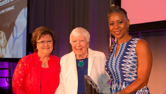 Larchmont resident Elaine Viebranz (center) poses with USTA Chair of Award Committee Nancy Alfano (left) and USTA CEO and President Katrina Adams (right) after recieving the inaugural USTA League Volunteer Award.
