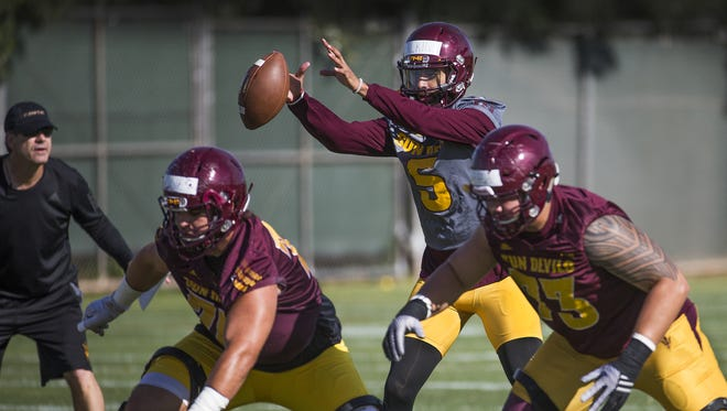 Quarterback Manny Wilkins takes a snap at a recent ASU practice.