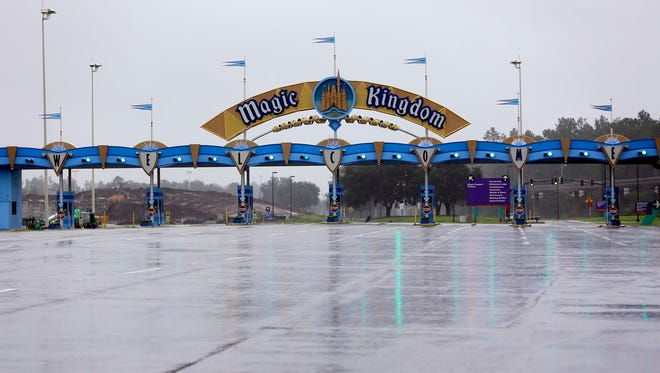 The entrance to the Magic Kingdom at Disney World is empty as the theme park was closed because of Hurricane Irma approaching the central Florida area, Sept. 10, 2017, in Lake Buena Vista, Fla. Other tourists attractions including Universal Studios and Sea World were also closed and planned to reopen Tuesday.