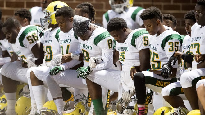 Hillsboro players kneel during the national anthem before a game between Beech and Hillsboro at Beech High School in Hendersonville, Tenn., Friday, Sept. 29, 2017.