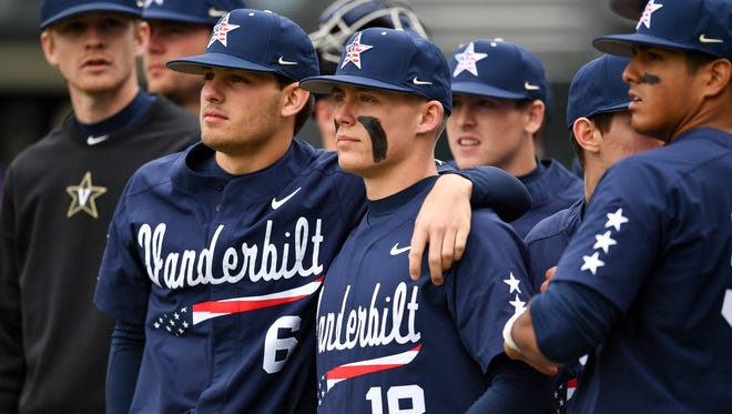 Vanderbilt's Justin Wilson (6) and center fielder Pat DeMarco (18) huddle up before facing LSU on Sunday at Hawkins Field.