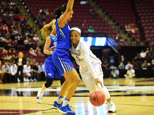 Graduate guard AJ Alix drives through the Buffalo defender in the Seminoles' second-round loss to in the NCAA Tournament.