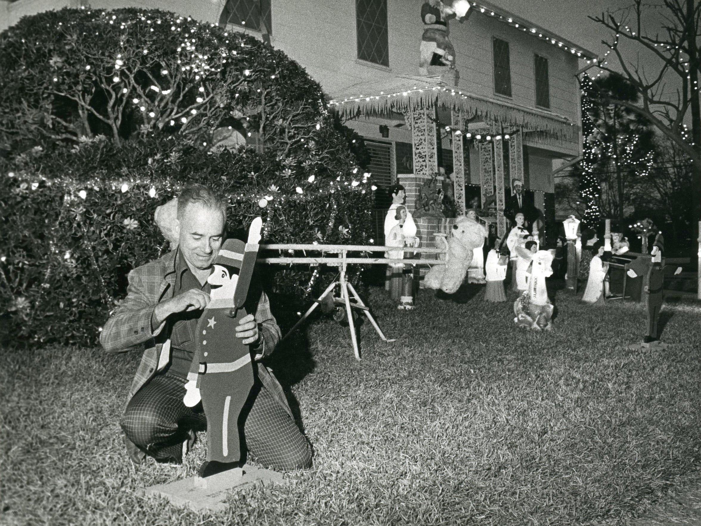 Billy Aldridge adjusts one of the multitude of Christmas