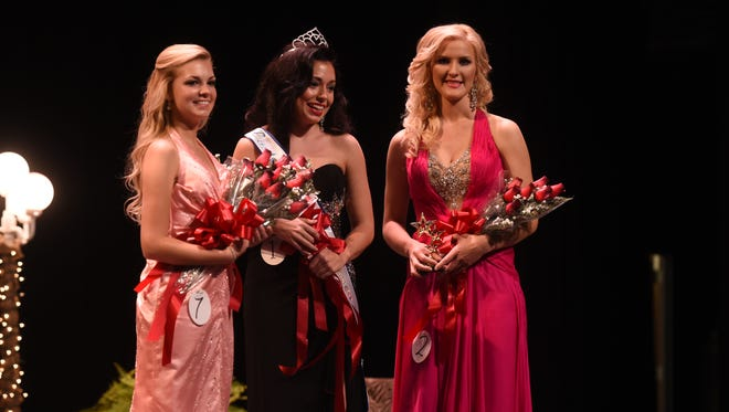 From left, First Runner-up Mandy Kilgore, Baxter County Fair Queen Samantha Shelley and Second Runner-up Lindsay Teegarden receive recognition on stage during Saturday night's pageant.